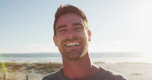 Free Happy Caucasian Man Standing And Smiling By The Sea Stock Photography - 214046662