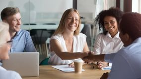 Free Happy Caucasian Manager And African Client Handshaking At Group Meeting Royalty Free Stock Photo - 144747785