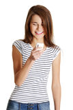 Happy caucasian teen with a mobile. Royalty Free Stock Images