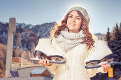 Happy caucasian teenager going to ice skating outdoor Stock Image