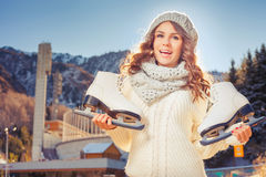 Happy caucasian teenager going to ice skating outdoor Stock Images