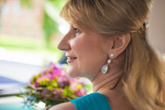 Happy Caucasian Woman with Bunch of Flowers Stock Image