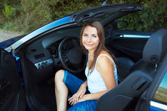 Happy caucasian woman in a cabriolet Royalty Free Stock Photos
