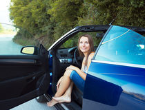 Happy caucasian woman in a cabriolet Royalty Free Stock Photo