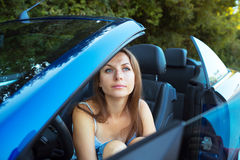Happy caucasian woman in a cabriolet Royalty Free Stock Image