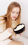 Happy caucasian woman is eating ice cream. Royalty Free Stock Images