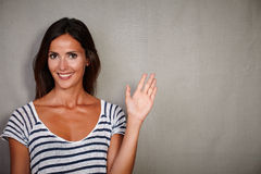 Happy caucasian woman greeting while smiling Royalty Free Stock Photography