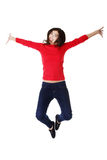 Happy caucasian woman jumping in the air Stock Images