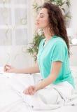 Happy Caucasian woman meditating Royalty Free Stock Photos