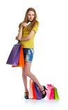 Happy caucasian woman with shopping bags and holding credit card Stock Photography