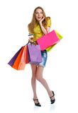 Happy caucasian woman with shopping bags and holding credit card Royalty Free Stock Photo