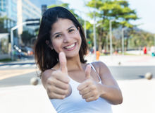 Happy caucasian woman showing both thumbs in the city Royalty Free Stock Image