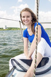 Happy Caucasian Woman Traveling on Yacht and Smiling Royalty Free Stock Photography