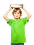 Boy with pile of books Royalty Free Stock Images