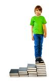 Boy standing on stairs of books Stock Image