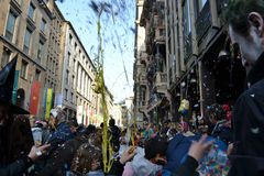 Happy celebrating of the Ambrosian Milan Carnival in Vittorio Emanuele main street. Royalty Free Stock Photos