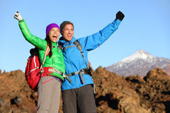 Happy celebrating hiking people at top stock image
