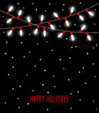 Happy Celebration Christmas New Years Birthdays and other events  led lights bulbs lamps in white and red colors. Hanging garland on black background Royalty Free Stock Image