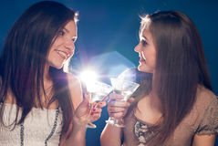 Happy celebration by two young beautiful woman Stock Photos