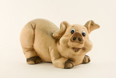 Happy ceramic piggy-bank, isolated Royalty Free Stock Photography