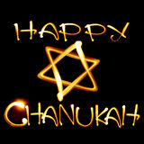 Happy Chanukah. Created by light text Happy Chanukah and jewish star over black background royalty free illustration