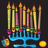 Happy Chanukah Menorah. Menorah surrounded by fun and colorful dreidel and gelt Royalty Free Stock Images