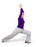 Happy charming beautiful elderly woman doing exercises while working out playing sports royalty free stock image