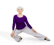 Happy charming beautiful elderly woman doing exercises while working out playing sports Stock Images