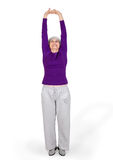 Happy charming beautiful elderly woman doing exercises while working out playing sports Royalty Free Stock Images