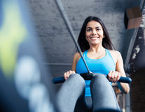 Happy charming woman working out at gym Royalty Free Stock Photo