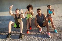 Happy cheerfuk people in sportswear resting Stock Photo
