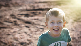 Happy cheerful boy walking outdoors Stock Images
