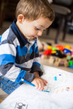 Happy cheerful child drawing at home Royalty Free Stock Photo