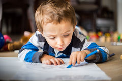 Happy cheerful child drawing at home. Creativity concept Royalty Free Stock Images