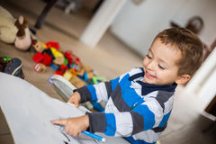 Happy cheerful child drawing at home. Creativity concept. Stock Photo