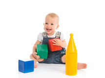Happy cheerful child playing with blocks cubes  on white Stock Images