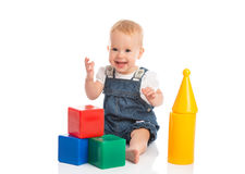 Happy cheerful child playing with blocks cubes  on white. Background Royalty Free Stock Photography