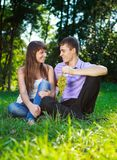 Happy cheerful couple with a bunch of grapes in th Stock Photos