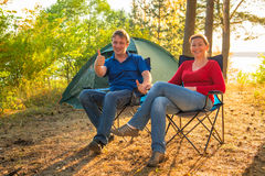 Happy and cheerful couple camping Stock Image