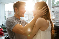 Happy cheerful couple celebrating new car purchase Stock Images