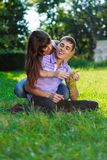 Happy cheerful couple fooling around in a summer sunny park Royalty Free Stock Image