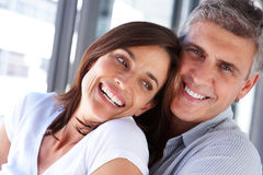 Happy cheerful couple laughing together Stock Photography