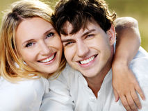 Happy Cheerful Couple On Nature Royalty Free Stock Photography