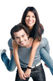 Happy cheerful couple piggyback Stock Photos