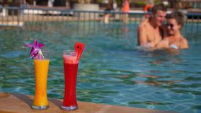 Happy Cheerful Couple in Swimming Pool in Hot. Sunny Day on Vacation in Krabi, Thailand. HD, 1920x1080 stock footage