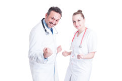 Happy and cheerful doctors act like winners Royalty Free Stock Photography
