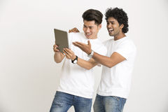 Happy Cheerful face college students using digital tablet Royalty Free Stock Photography