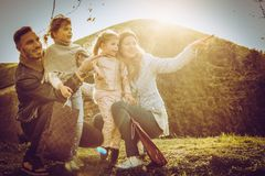 Happy and  cheerful family enjoy in the park. Space for copy Stock Image
