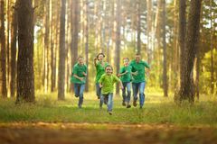 Happy cheerful family running Stock Images