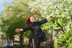 Happy cheerful forty-year-old woman outdoor. Happy cheerful forty-year-old woman in a black suit outdoor stock photos